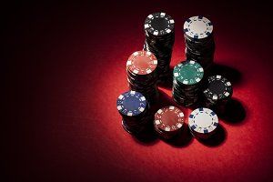 Gambling chips on red surface