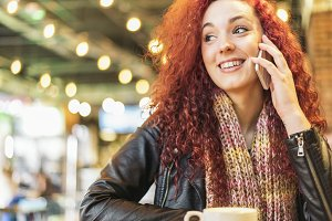 Young woman using mobile phone.