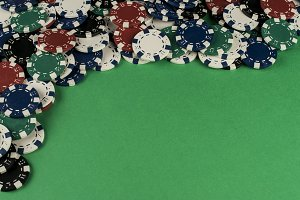 Gambling chips of green table