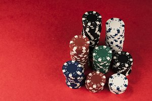 Gambling chips on red table