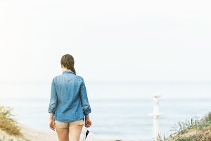 Pretty woman walking on the beach.