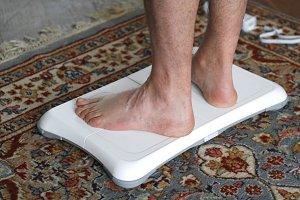 Men's feet on a balance board