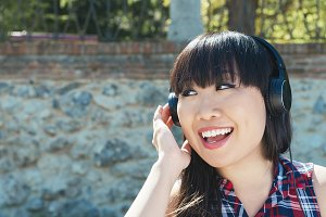 Chinese woman listening music.