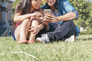 Young couple using mobile.