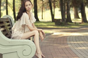 woman on a park bench