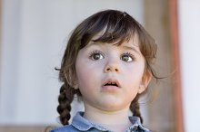 Cute little girl with dandelion
