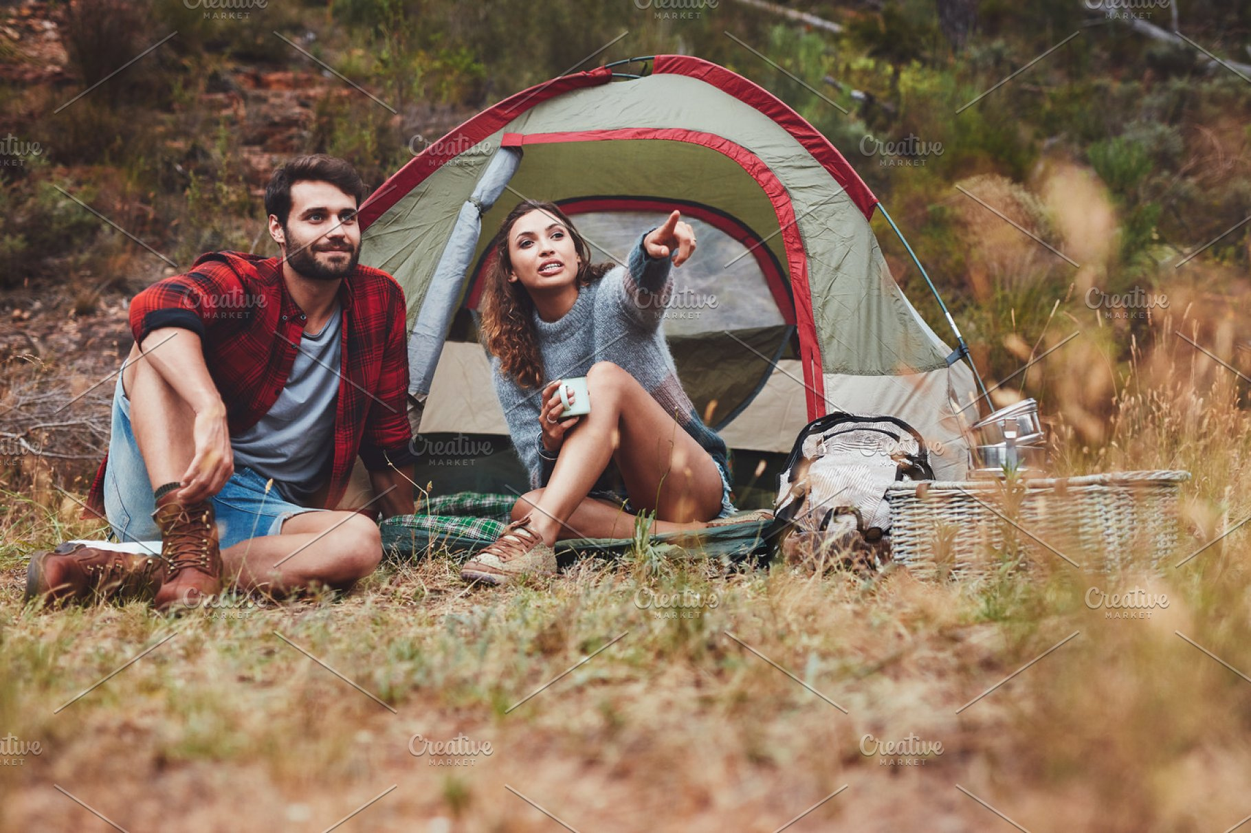 Young couple camping in nature | High-Quality People Images ...