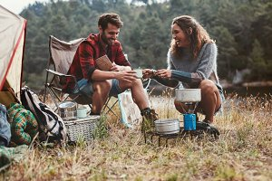 Happy young couple camping