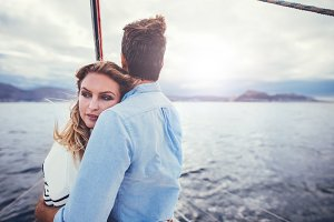 Loving young couple on a boat trip
