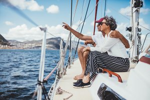 Senior couple sitting on boat