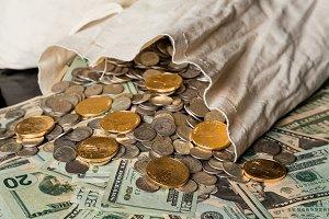 Piles of US dollar bills and cash