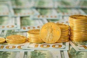 Gold coins on US dollar bills