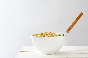 Quinoa salad on white wooden table
