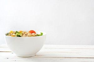 Quinoa salad on white wooden table