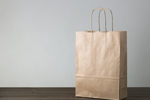 disposable bag of kraft paper on a wooden table