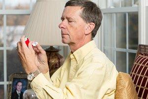 Senior man with asthma inhaler