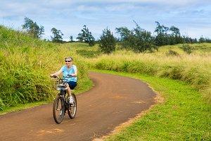 Senior lady on bike path
