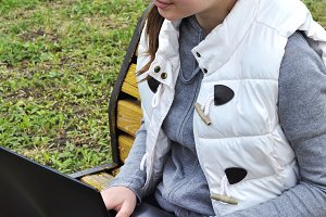 Girl with laptop in the park