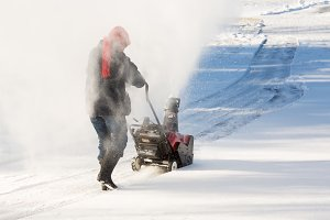 Senior woman with snow blower