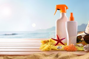 Suncream on the beach horizontal