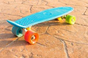 Blue skate board at park garden.