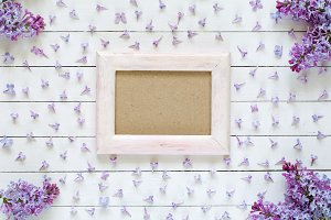 Photo frame and lilac flowers
