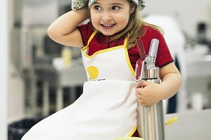 Sweet girl cooking in a kitchen.