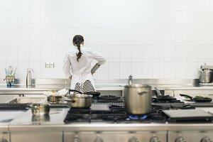 Chef cooking in a kitchen.