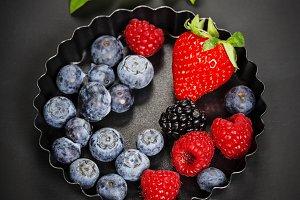 Fresh Berries on Dark Background