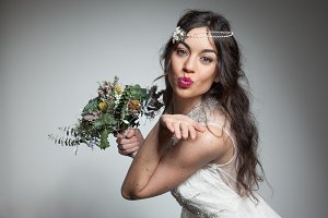 Happy bride sending a kiss