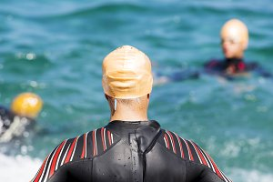 triathletes preparing swim race