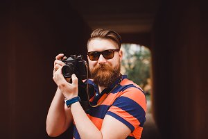 Hipster man with vintage camera