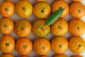 ripe tangerines stacked together