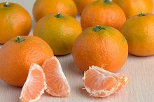 Ripe tangerines on the table closeup