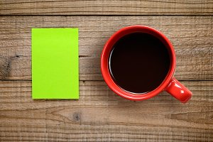 Post-it note and coffee cup