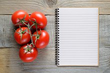 Tomatoes and recipe book