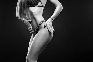Beautiful curvaceous brunette woman posing in a bikini