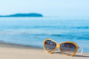 Fashion sunglasses on the beach