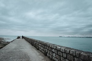 Seafront raod go aside the bay of sea in a cloudy day