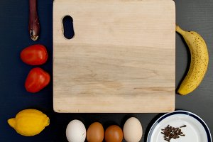 cutting board and fruits, eggs