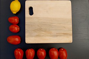cutting board, lemon, tomatoes