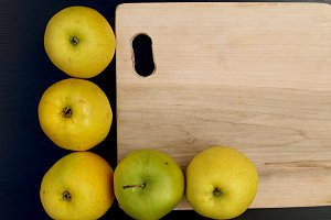 cutting board and apples