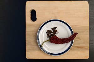 red pepper and cutting board