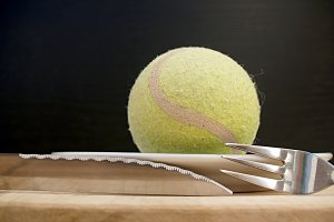 tennis ball and cutlery