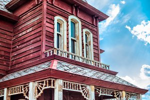 Old american western red house