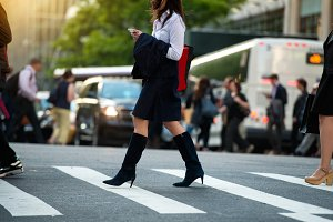 Businesswoman walking on crosswalk