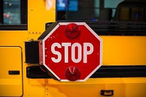 yellow school bus stop sign