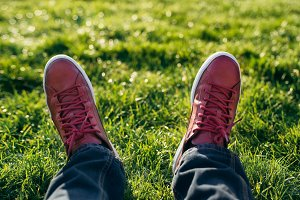 Man feet wearing red shoes