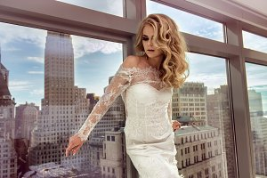 Beautiful bride posing in penthouse