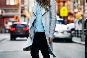 smiling woman walking on city